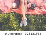 relaxing in a meadow in the... | Shutterstock . vector #325131986