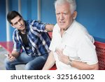Small photo of Retiree with chest pain and helpful young man