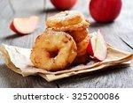 apple rings over baking paper... | Shutterstock . vector #325200086