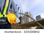 engineer holding a yellow... | Shutterstock . vector #325200842