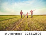 family running together in the... | Shutterstock . vector #325312508