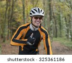 portrait of a happy cyclist... | Shutterstock . vector #325361186