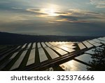 sunset over the solar power... | Shutterstock . vector #325376666