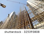 steel grid on the construction... | Shutterstock . vector #325393808