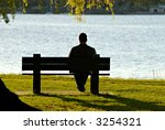 Young Man Sitting Alone On Par...