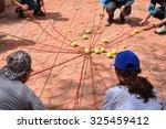 team building activity  tennis... | Shutterstock . vector #325459412