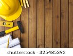 Construction Tools On A Wooden...