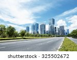 asphalt road of a modern city... | Shutterstock . vector #325502672