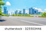 empty asphalt road in modern... | Shutterstock . vector #325503446
