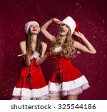 two sexy women scream and laugh ... | Shutterstock . vector #325544186