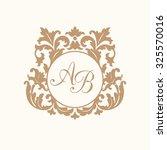 elegant floral monogram design... | Shutterstock .eps vector #325570016