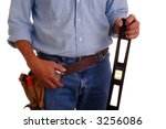 Carpenter wearing a toolbelt holding a long level isolated over white - stock photo