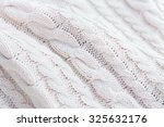 white knit fabric texture and... | Shutterstock . vector #325632176