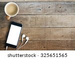 phone and coffee on wood blank... | Shutterstock . vector #325651565