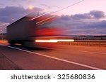 truck on a highway in the night | Shutterstock . vector #325680836