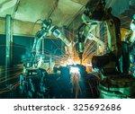 team welding robots represent... | Shutterstock . vector #325692686