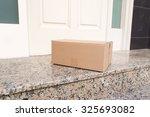 carton box on the floor of... | Shutterstock . vector #325693082