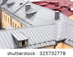 Wet New Metal Roofs Of Old...