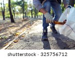 young man picking up trash... | Shutterstock . vector #325756712