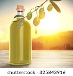 bottle of oil with olive branch | Shutterstock . vector #325843916