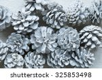white fir cones on wooden... | Shutterstock . vector #325853498
