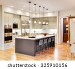 kitchen interior with island ... | Shutterstock . vector #325910156