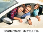 cheerful guy with two girls in... | Shutterstock . vector #325911746