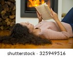 beautiful woman reading a book... | Shutterstock . vector #325949516