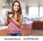 young woman holding a vintage... | Shutterstock . vector #325958102