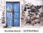 Old Weathered Door In Greece