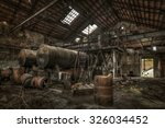 Rusty Cisterns And Barrels In...