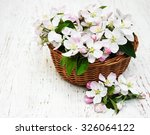 basket with apple blossoms on a ... | Shutterstock . vector #326064122