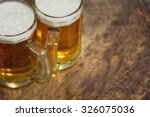 Two Cold Beer Jug On Wooden...