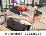 two girls are exercising... | Shutterstock . vector #326136188