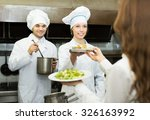 positive cook gives to female... | Shutterstock . vector #326163992