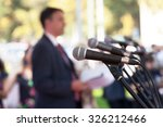 news conference. microphones. | Shutterstock . vector #326212466
