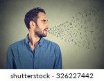 man talking with alphabet... | Shutterstock . vector #326227442