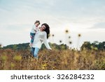 mother and daughter playing on... | Shutterstock . vector #326284232