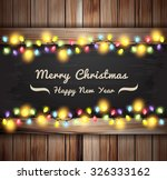 christmas lights on wooden... | Shutterstock .eps vector #326333162