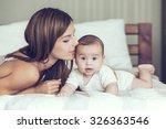 Portrait Of Beautiful Mother...