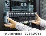 it engineer installs enclosure... | Shutterstock . vector #326419766