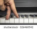 Fingers Click On The Piano Keys ...