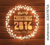 glowing christmas lights wreath ... | Shutterstock .eps vector #326478716
