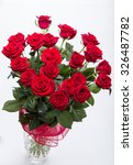 Stock photo bouquet of blossoming dark red roses 326487782