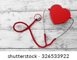 red stethoscope with heart on... | Shutterstock . vector #326533922