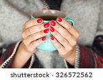 Stock photo female hands holding a mug of hot tea 326572562