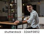 businessman sitting in coffee... | Shutterstock . vector #326693852