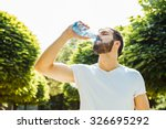 close up of a man drinking... | Shutterstock . vector #326695292
