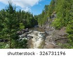 rushing river from cliff | Shutterstock . vector #326731196