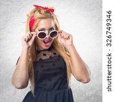 woman doing surprise gesture | Shutterstock . vector #326749346